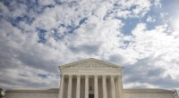 This Oct. 13, 2015, photo shows the Supreme Court in Washington. The Supreme Court has so far resisted elaborating on two landmark decisions that established a nationwide right to defend one's home with a gun. That could change with a new appeal filed by gun owners that challenges a Chicago suburb's assault weapons ban. (PHOTO CREDIT: AP Photo/Jacquelyn Martin)
