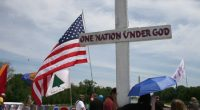 (PHOTO: THE CHRISTIAN POST) In this file photo, a cross and the American flag are held up during a rally in Washington, D.C., May 2010.
