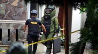 Indonesian antibomb squad carry an explosive from the Santo Yosef chuch after a man tried to attack a priest in Medan on August 28, 2016.   A knife-wielding attacker in Indonesia stabbed a Catholic priest and tried to set off an explosive device at a church on, police said, the latest in a string of attacks on religious minorities in the mainly Muslim country. / AFP / HAKIM RANGKUTI        (Photo credit should read HAKIM RANGKUTI/AFP/Getty Images)