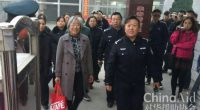 Escorted by government officials, Yang Rongli leaves Shanxi Women's prison. (Photo: China Aid)